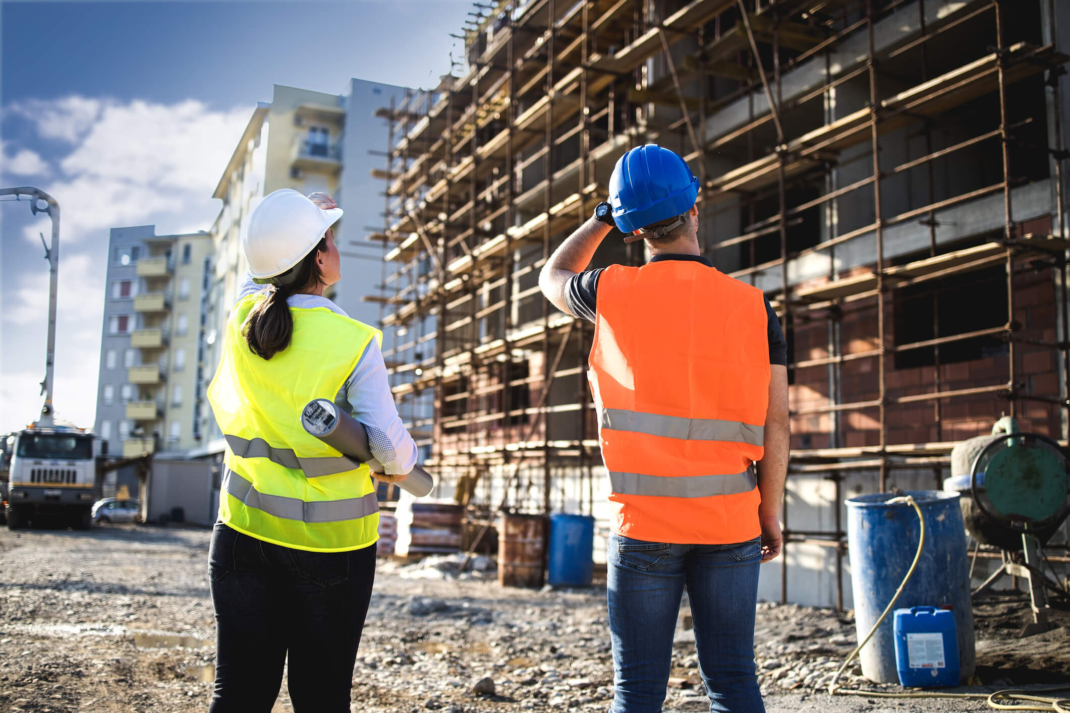 Man and woman talking at a construction site