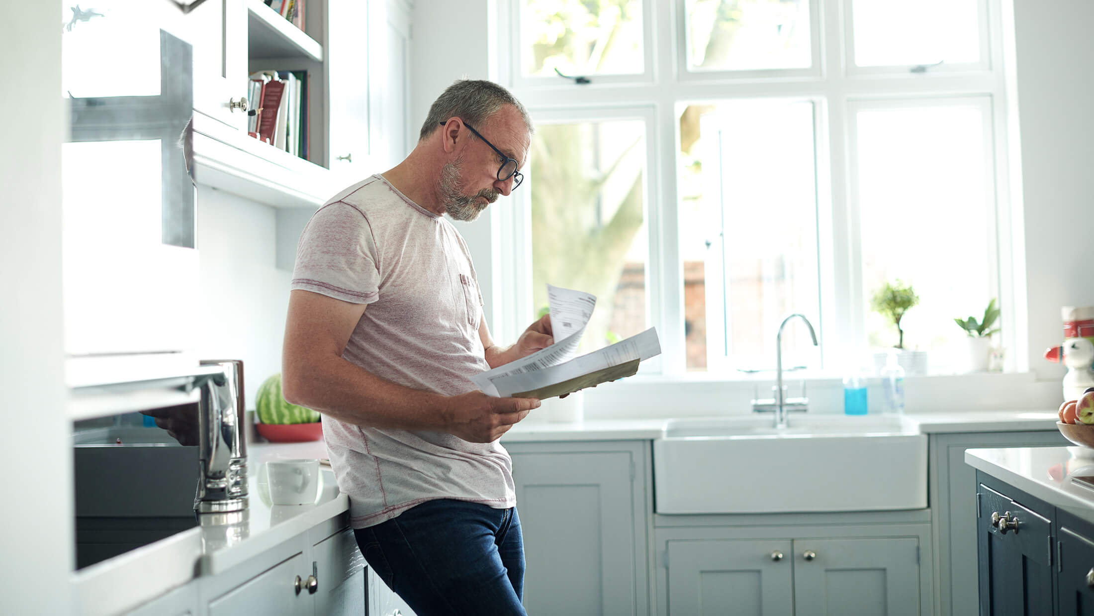 Mature man reading documents